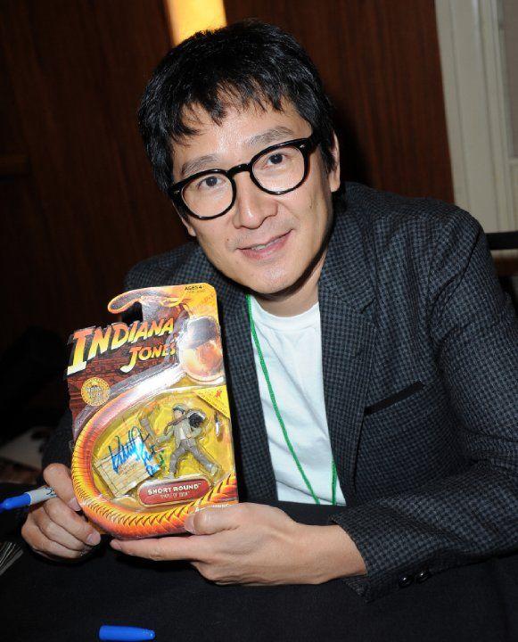 Jonathan Ke Quan now holding signed Indiana Jones toy