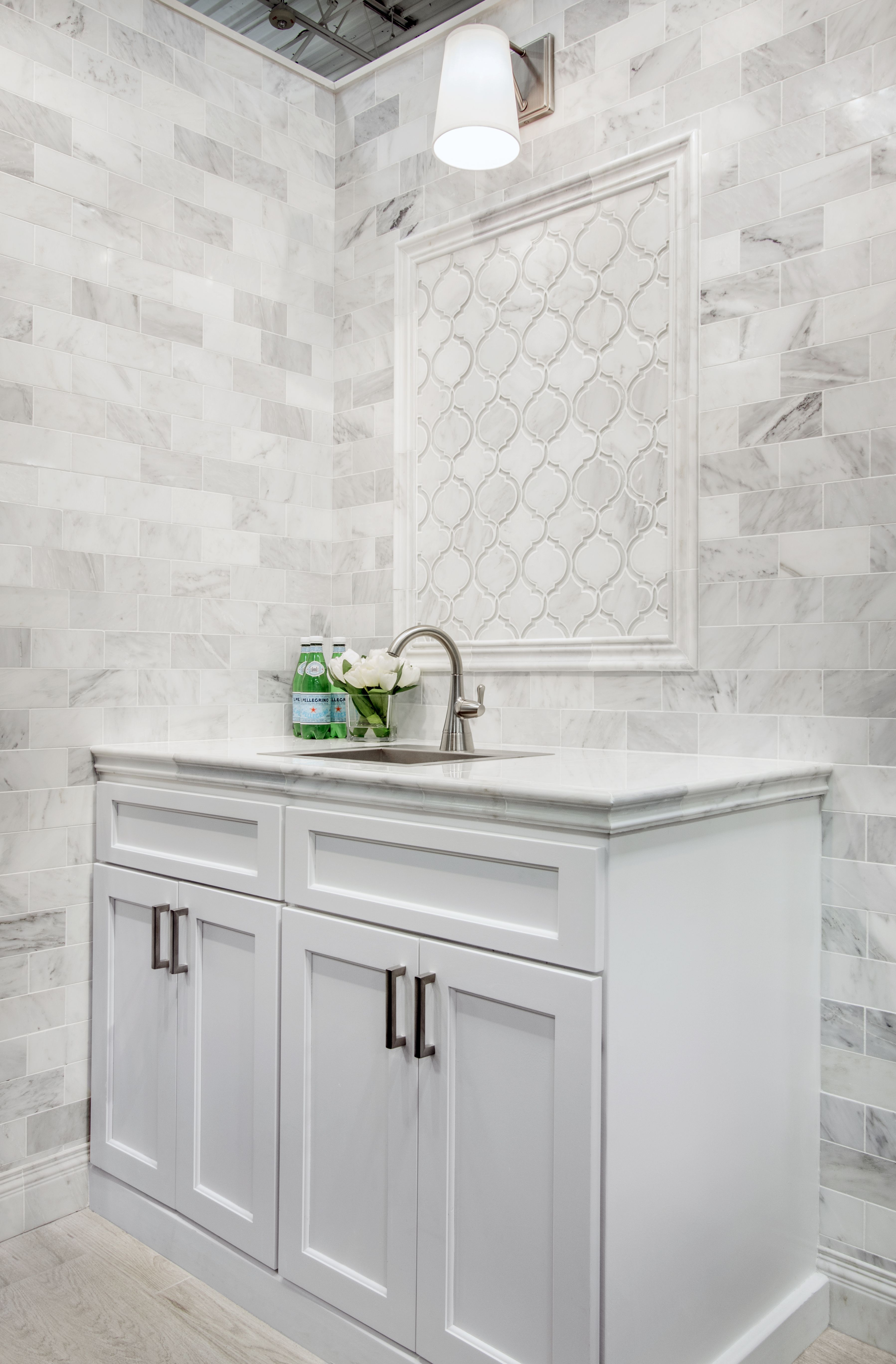 With a sleek glass tile border around each shape, this wavy ...