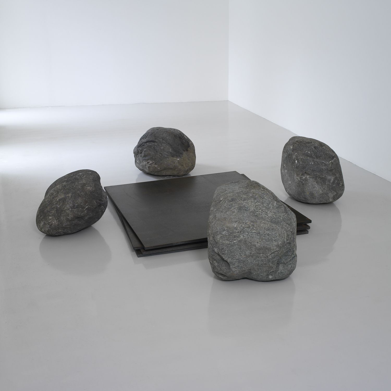 Lee Ufan, Relatum - Discussion, 2003. Four iron plates and four stones.