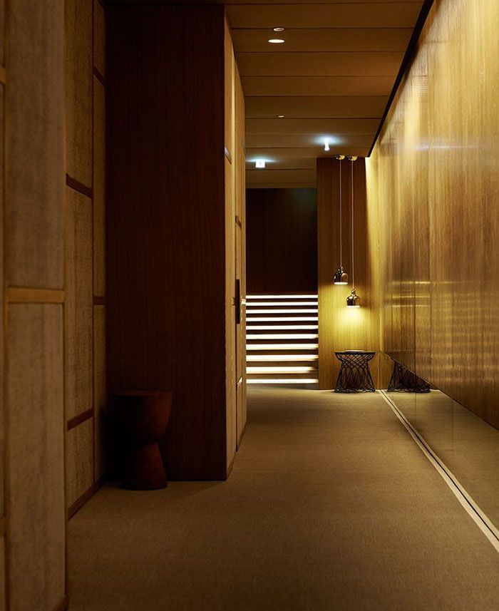 Spa at four seasons milano is furnish with wood cream and for Interior designer milano