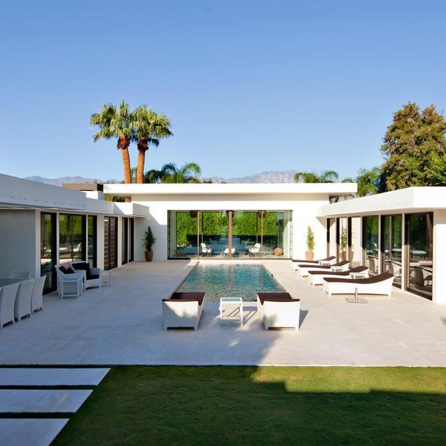 Modern Backyard fers Ample Seating & Swimming Pool