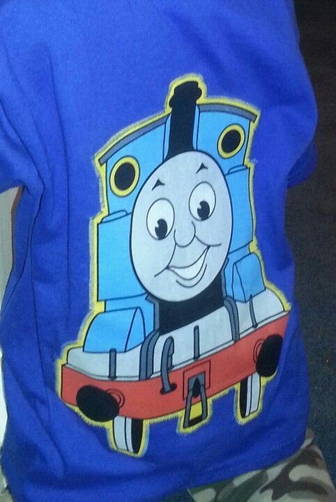 DIY Thomas the Train shirt...made with a fabric applica....easy to make!   Get a shirt from the craft store (usually on sale for about $2.99) Fabric, and some heat & bond. Iron the heat & bond to the fabric. Iron the fabric to the shirt. Finish the edges with zigzag stitch or fabric paint. The whole shirt will cost about $6.00. Give or take....