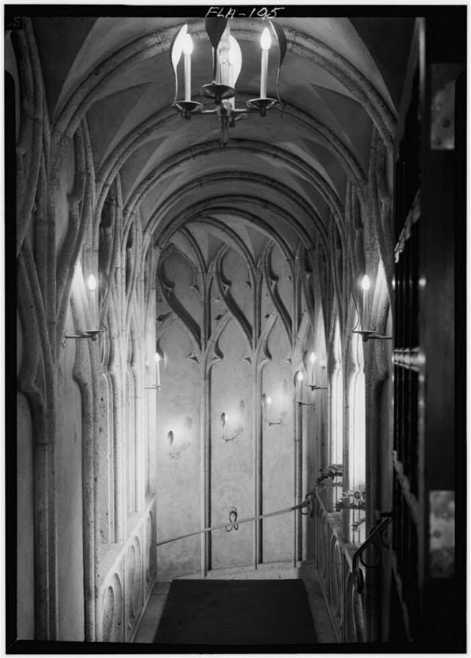 LOOKING DOWN GOTHIC STAIRWAY FROM SECOND FLOOR