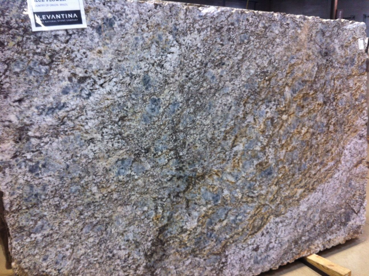 Just In Blue Fire Granite From Brazil Is A Swirling Dramatic Blue Stone With Both Light And Darker Vein Granite Countertops Light In The Dark Inspiration Wall