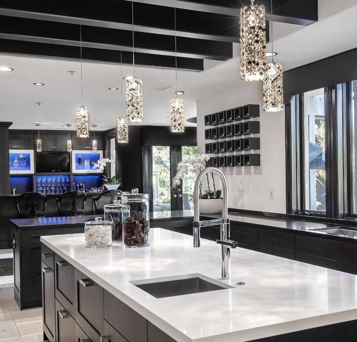 Who doesn't love a modern kitchen. | Black quartz kitchen ... on Modern Kitchen Countertop Decor  id=13791