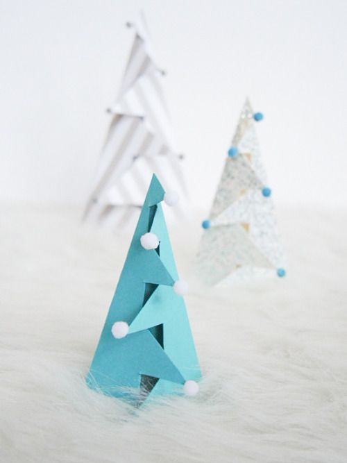 a sheet of fancy card stock a few clever cuts and a couple of folds is all you need to make standing christmas trees