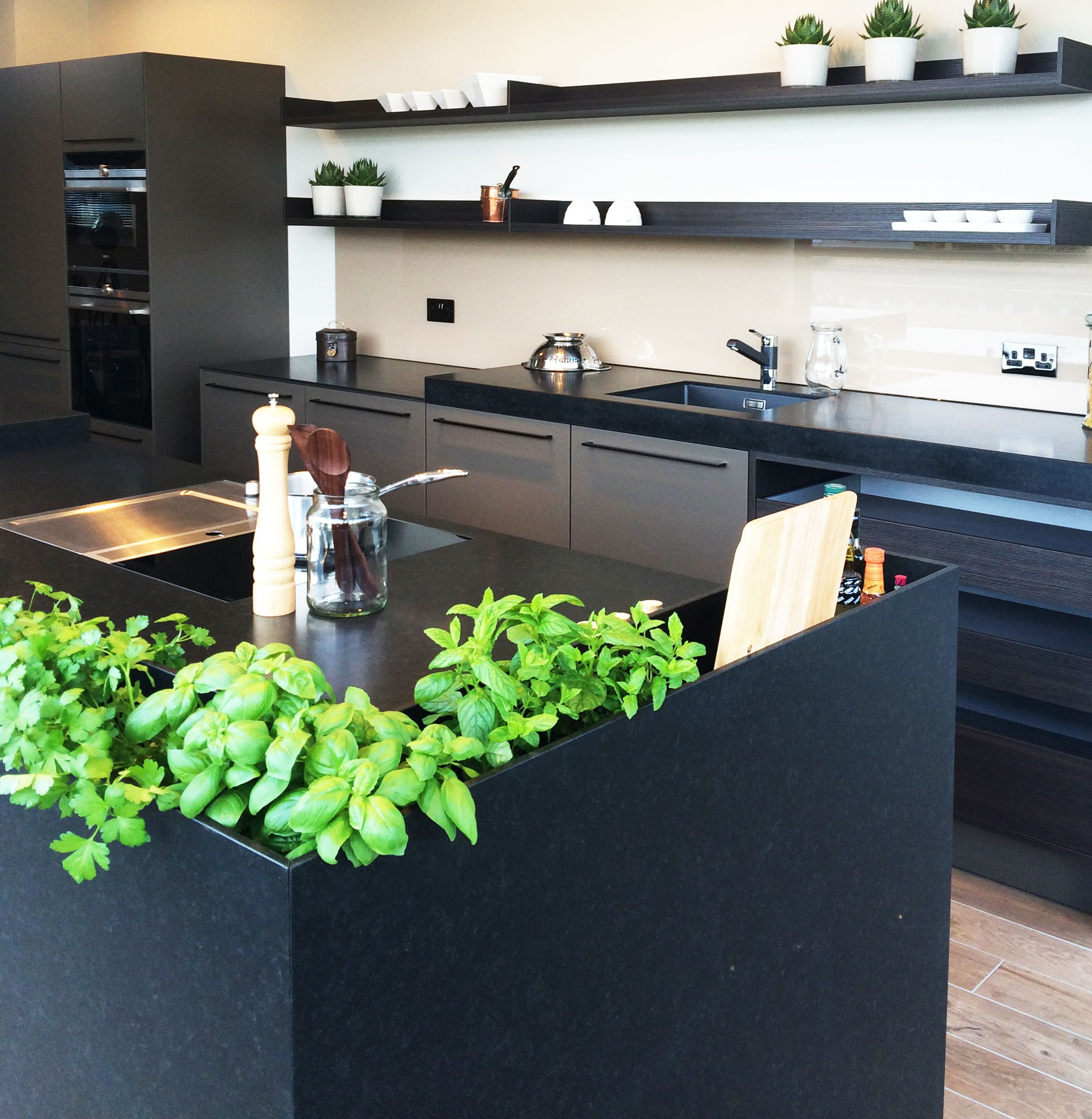 Our very own living herbs growing in the display SieMatic HD8