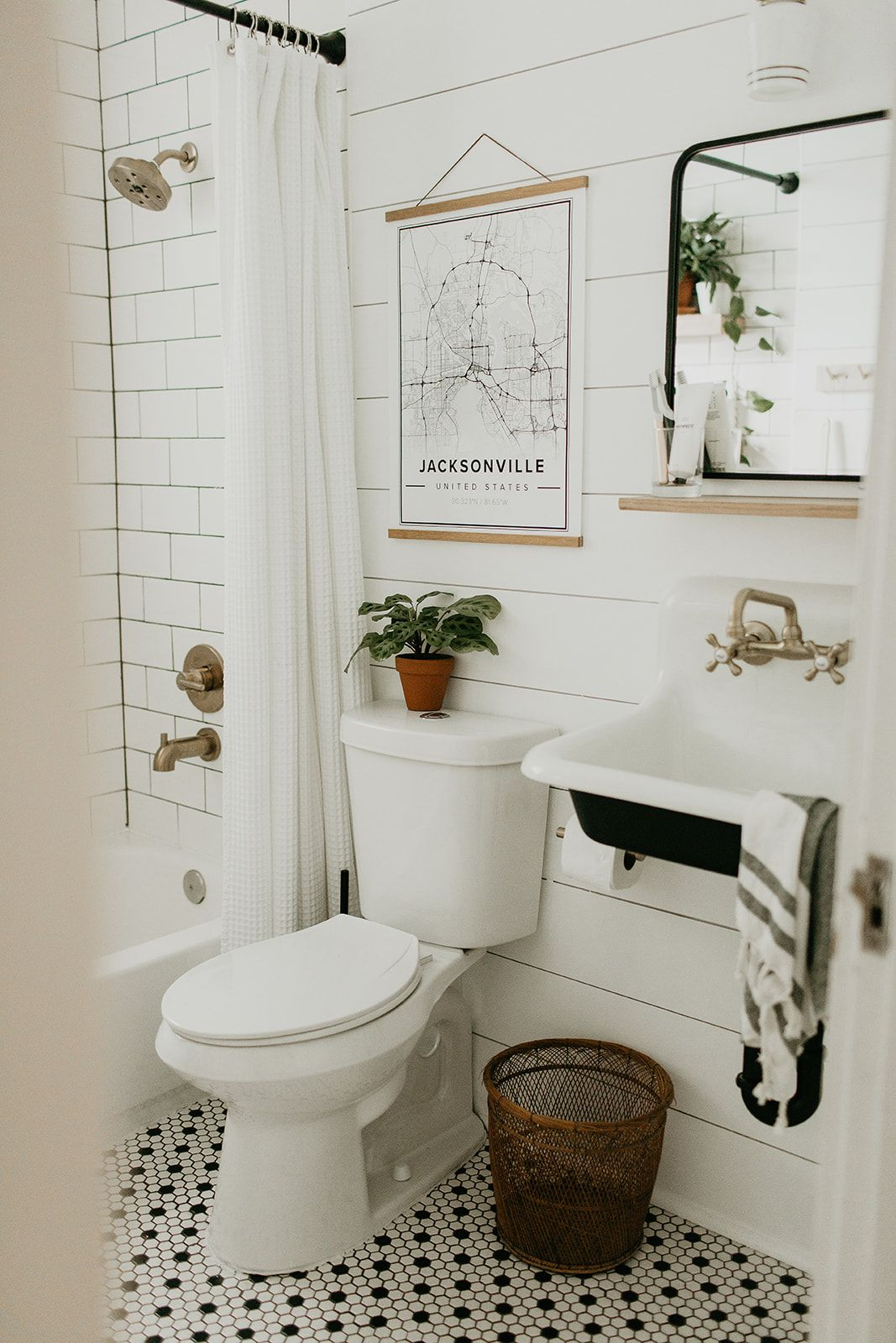 Bathroom renovation, modern vintage bathroom, farm sink, black white brass, shiplap, house plants. #modernvintagedecor