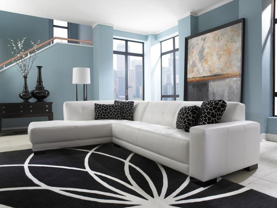 Modern Living Room With L Shaped White Leather Chesterfield Sectional With Black Velvet Cushions A Schwarze Wohnzimmermobel Schwarze Wohnzimmer Wohnzimmermobel