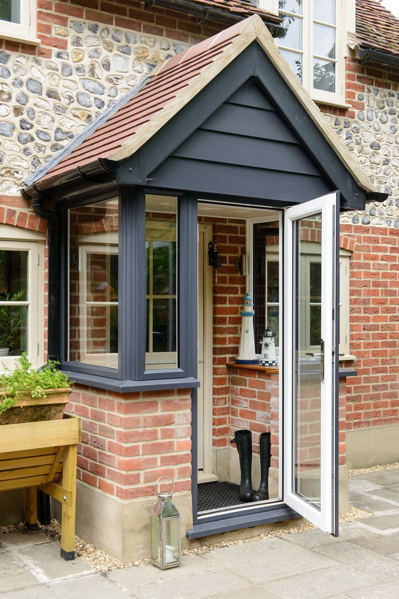 Porches And Doors Create A Stunning Entrance To Any Home This Anglian Anthracite Grey Porch With Pitched Roof Brick Porch House With Porch Front Porch Design