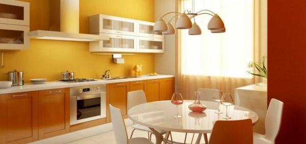gelbe k chen wandfarbe in einer sch nen k che mit einem runden tisch k che pinterest gelb. Black Bedroom Furniture Sets. Home Design Ideas