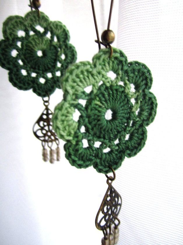 Do you want to put some fun and uniqueness in your outfit... Well you have to get these gorgeous and delicate earrings. The flower is crocheted with acrylic thread and features a hanging bronze...