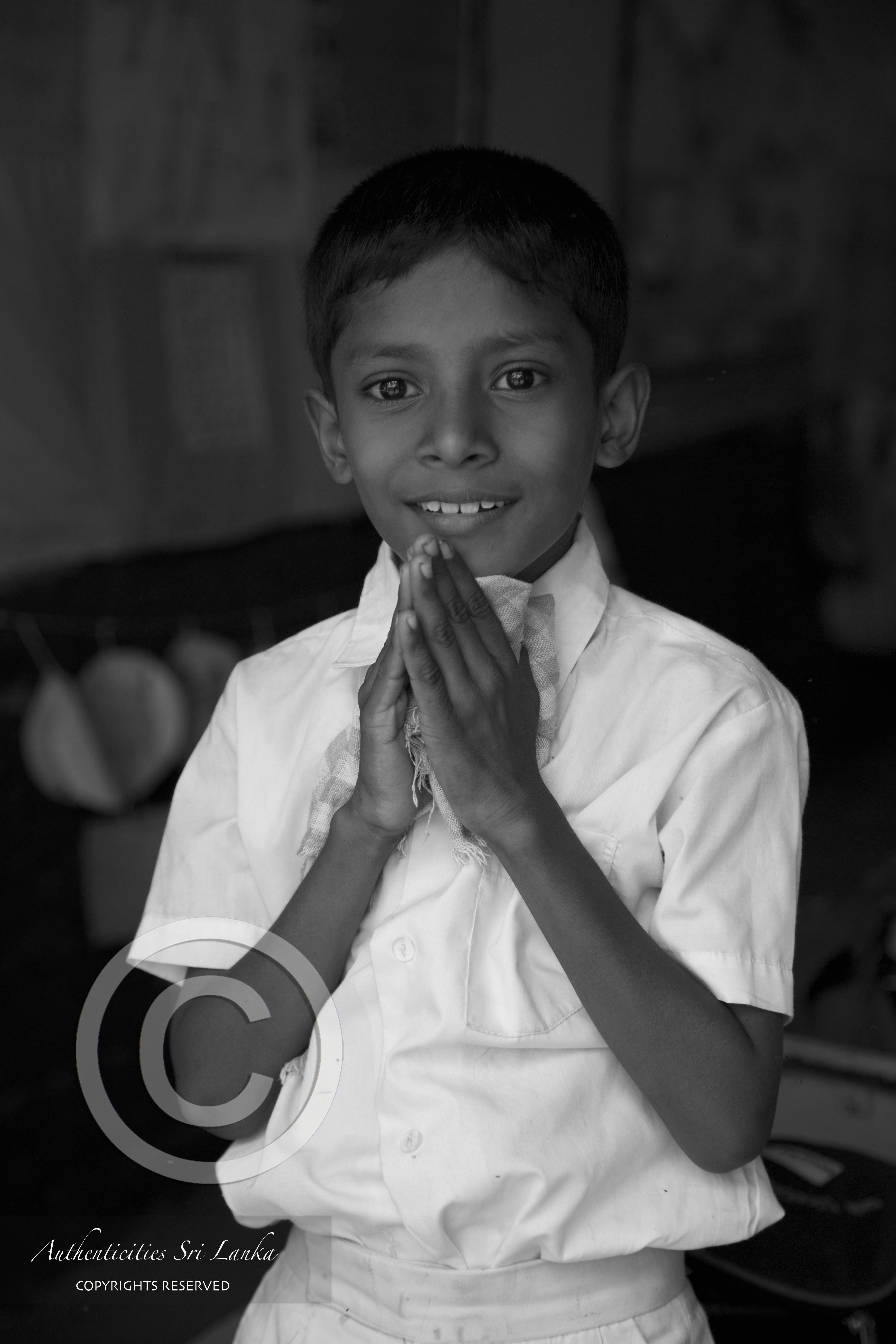 A Schoolboy From A Remote Local School Greeting In A Traditional
