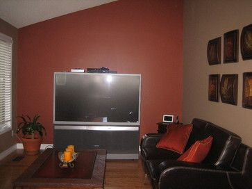 Burnt orange living room wall with black couch and light brown side walls would go lighter for Black and burnt orange living room
