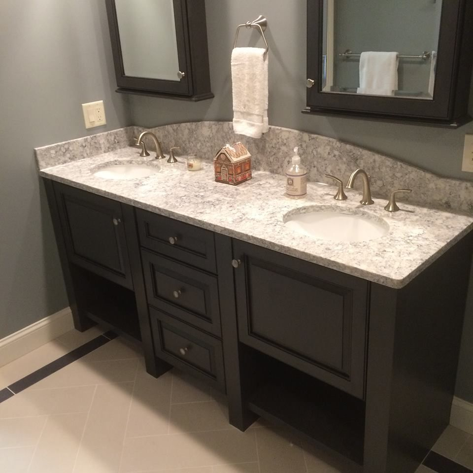 Black and white bathroom. Double vanity in a black Feathered glaze ...