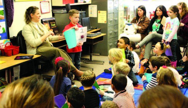 Max Yospe, with the support of teacher Sally Sadler, shares a book he created about his favorite habit with fellow classmates and visitors at a Leader in Me symposium.  Photo by Louise R. Shaw | Davis Clipper
