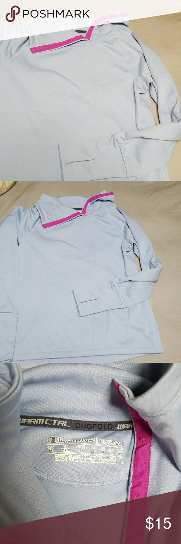 Light blue athletic fleece pullover Cute light blue pullover with bright pink detail trim when neck is folded over.  Thumb holes! Cozy fleecey inside.  Button up cowl neck. Notice tiny snag in 4th picture. Champion Sweaters