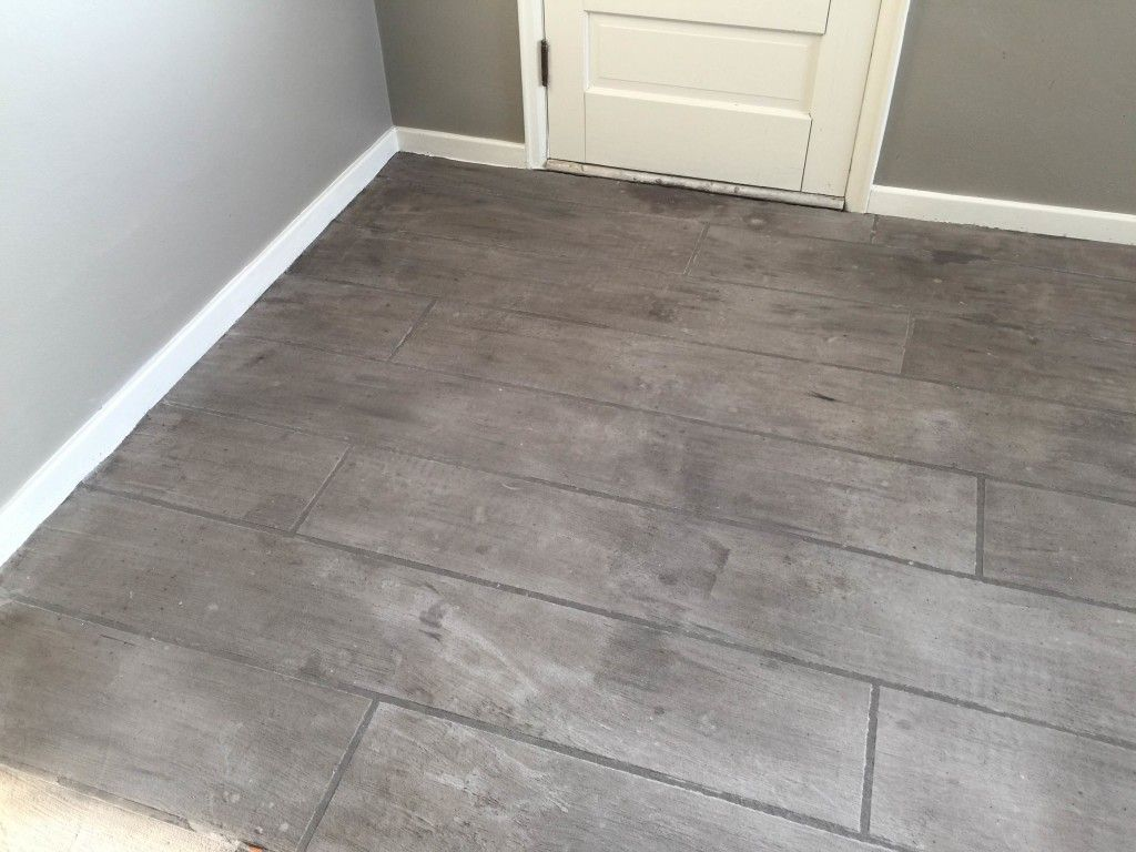 Grey Wood Look Concrete Overlay Is The Perfect Durable Flooring Option For Any Space That Needs A Grea Durable Flooring Wood Look Tile Flooring Options Durable