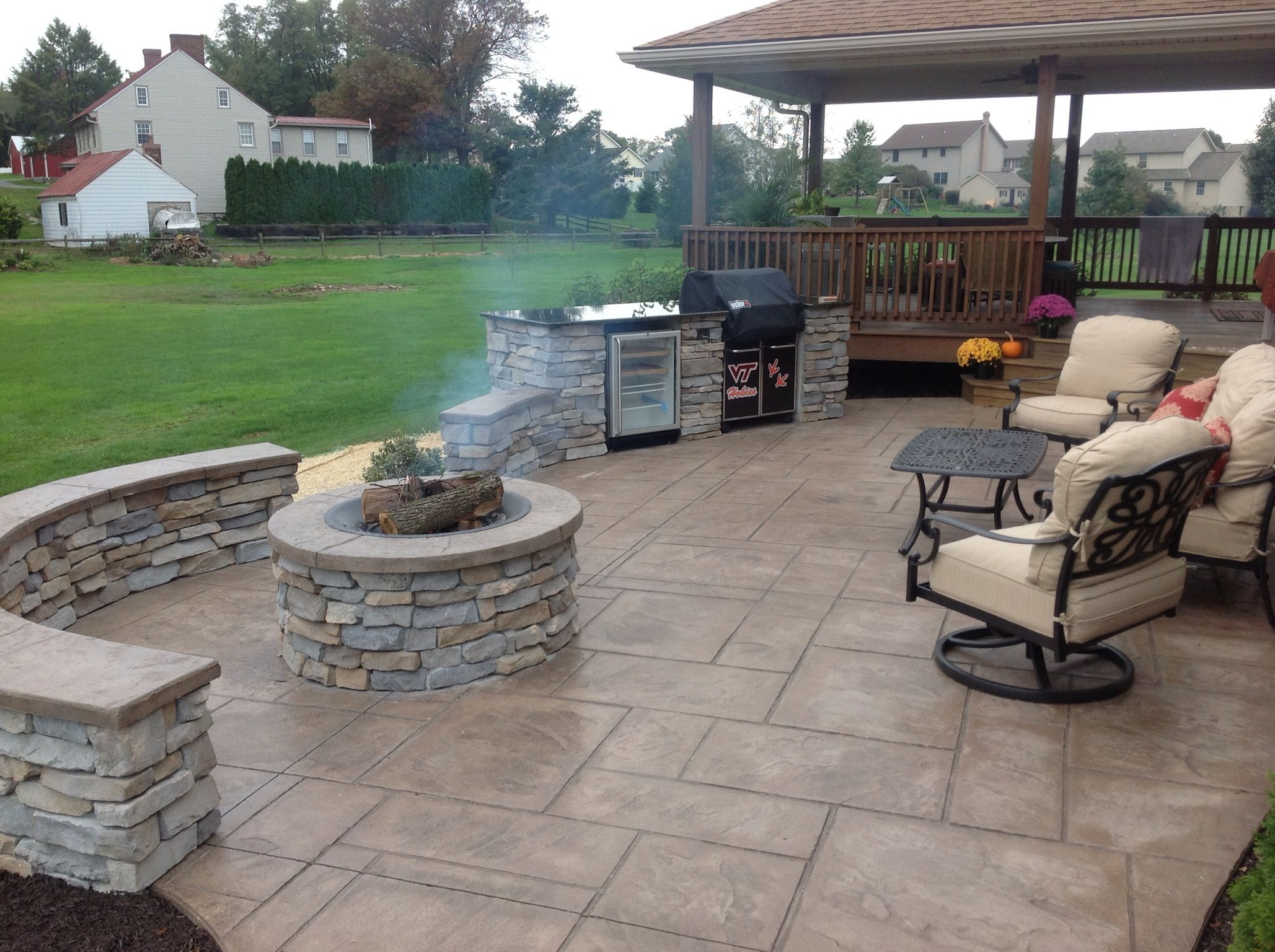 Stamped Concrete Patio With Stone Veneer Wall Grill Station And
