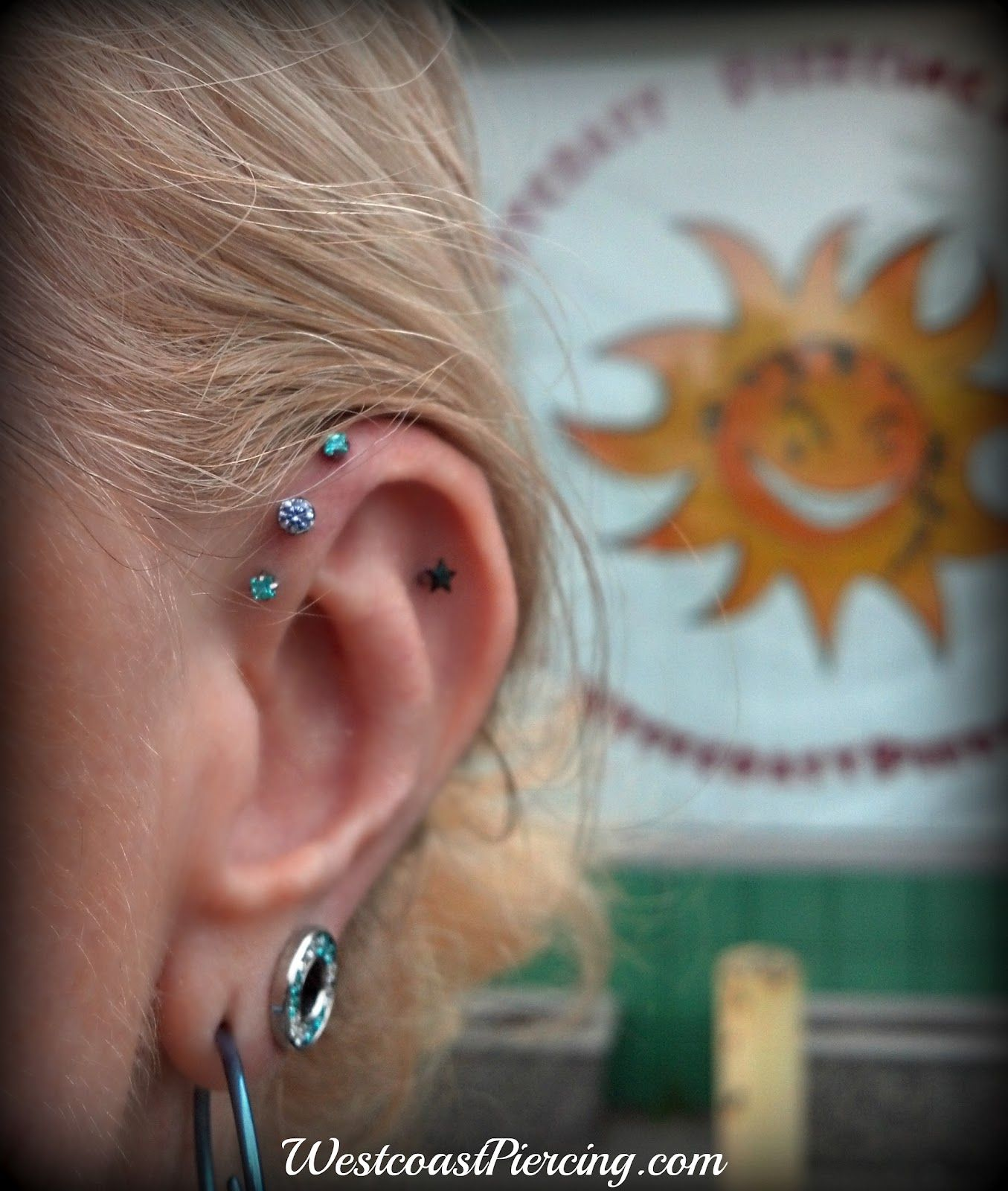 Piercing through bridge of nose  Triple Helix Piercing with  Mint Green Princess Cut jewels and a