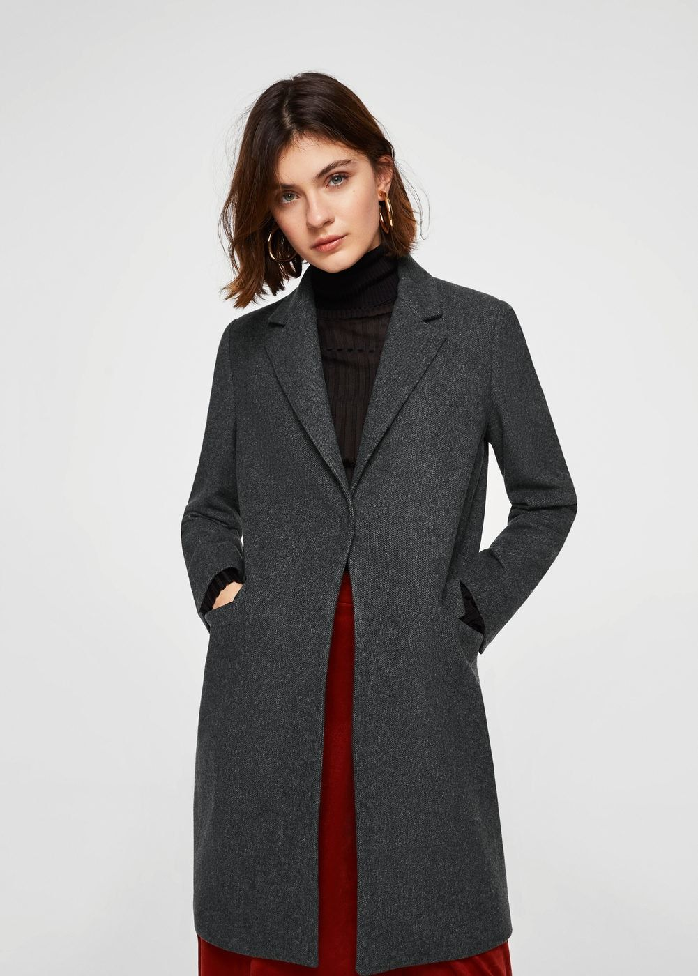 29356173ea Wool mix fabric Classic design Structured design Quilted panels on the  shoulders Lapels Two welt pockets on the front Long sleeve Inner lining