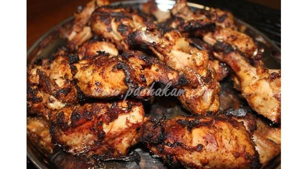 Chicken is marinated and barbequed