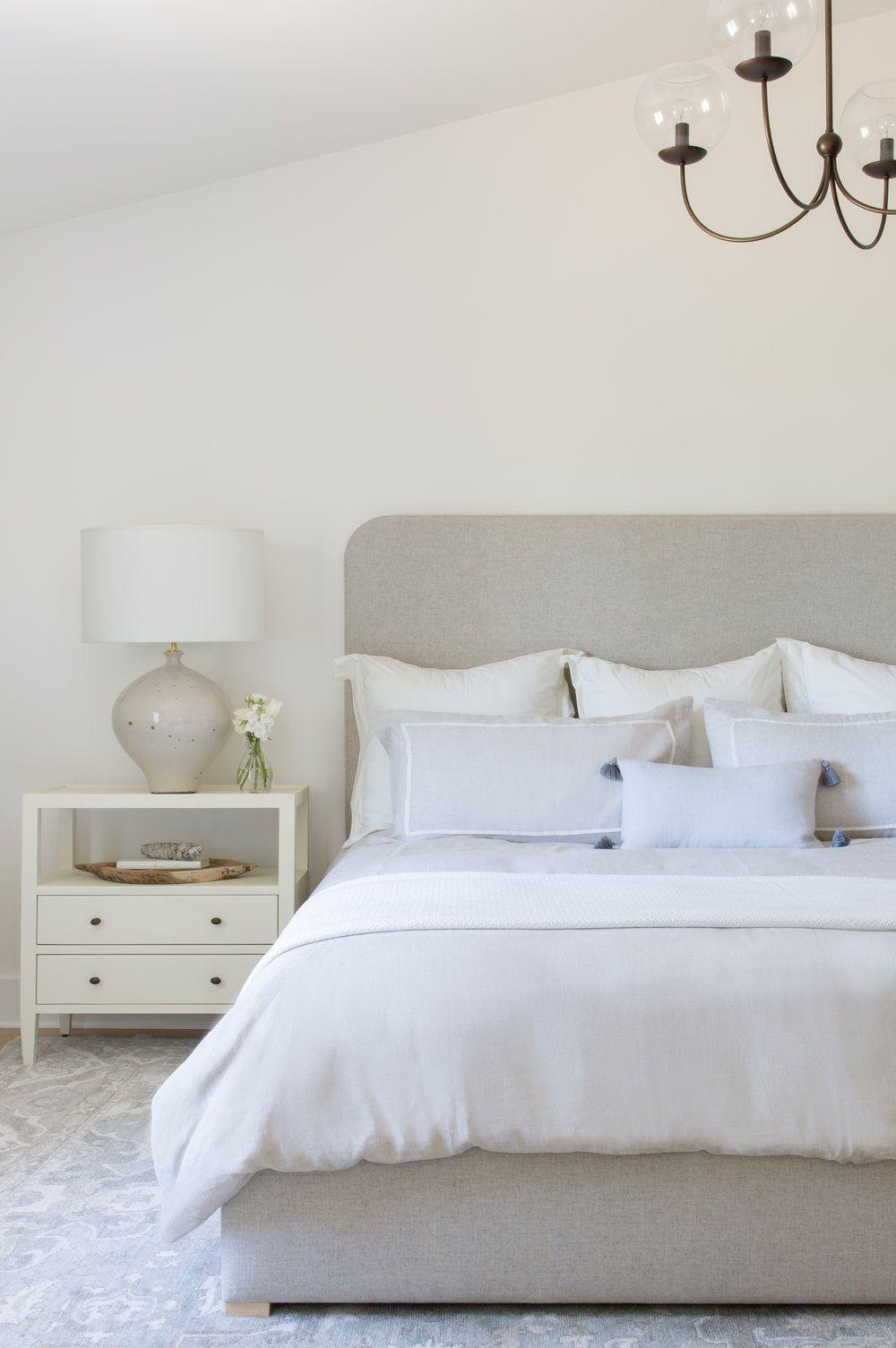 Neutral Bedroom Linen Upholstered Bed Frame Pillow Arrangement