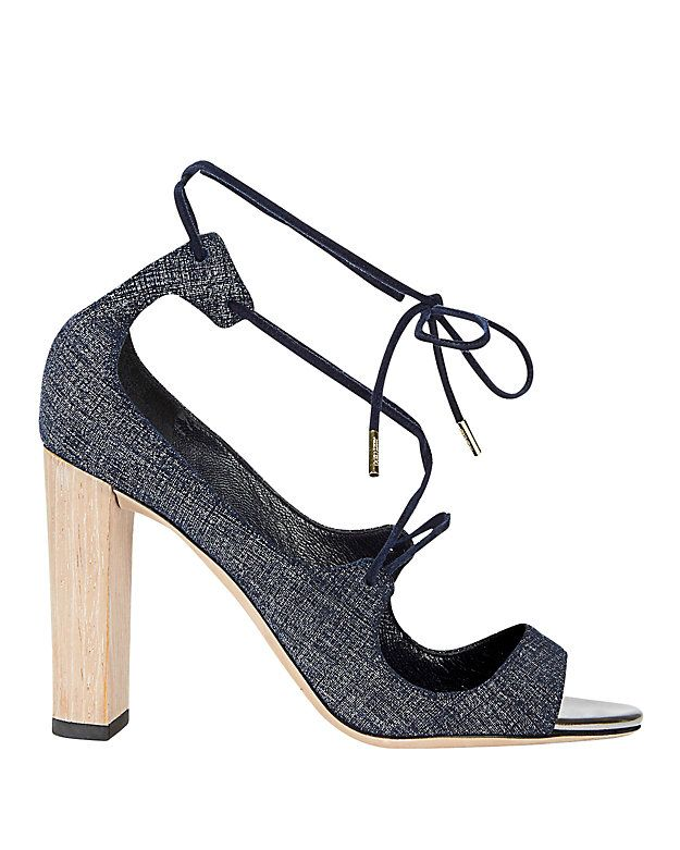 aa87e50a0c9a Jimmy Choo Vernie Tie Up Denim Sandal  An open-toe denim sandal with a 4  thick wooden heel and lace-up front. Leather soles. In denim. Made in .