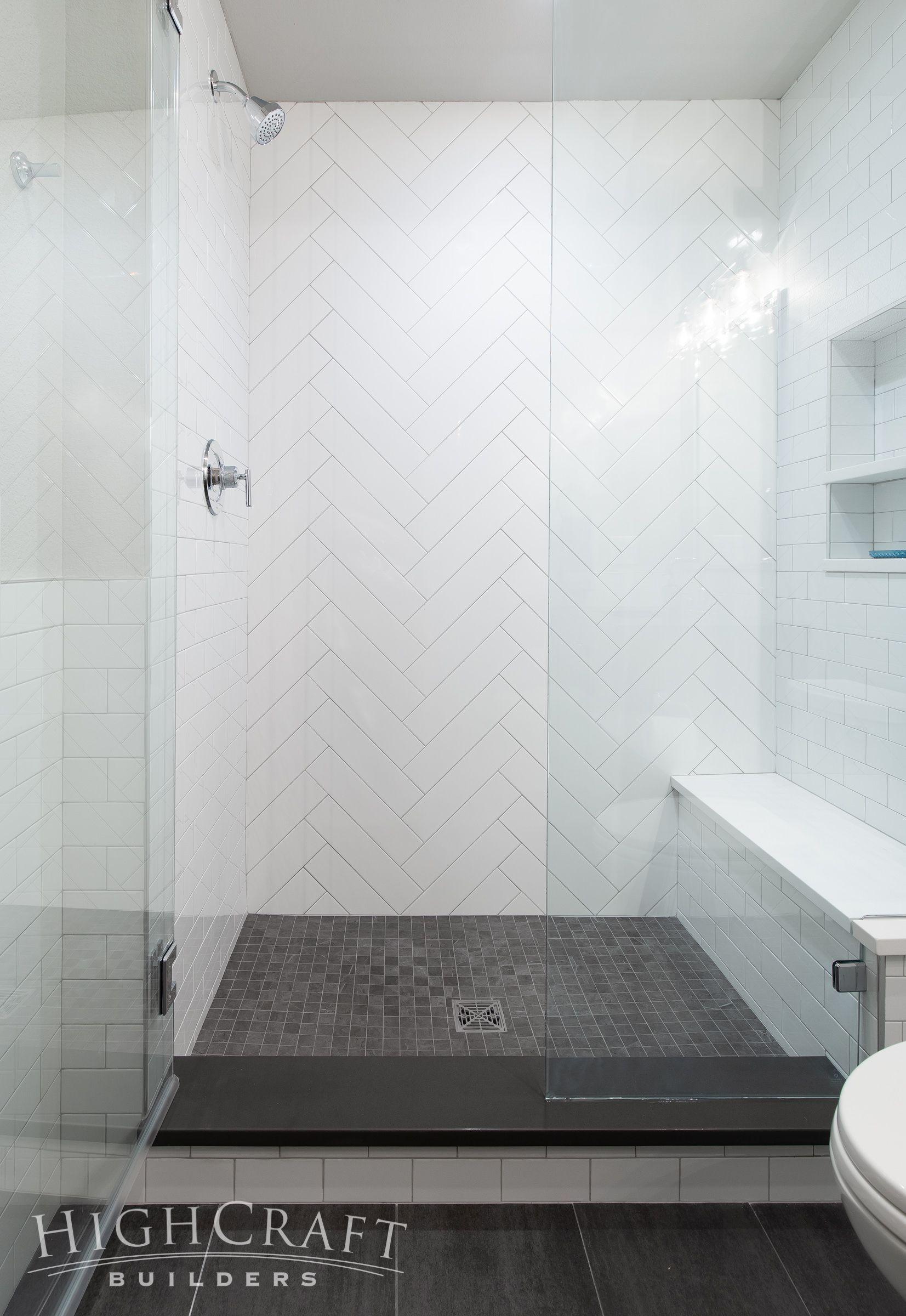 And 4 16 White Subway Tiles Create A Herringbone Accent Wall In The Shower Basementbathroom Bathroom Interior Tile Bathroom Bathrooms Remodel