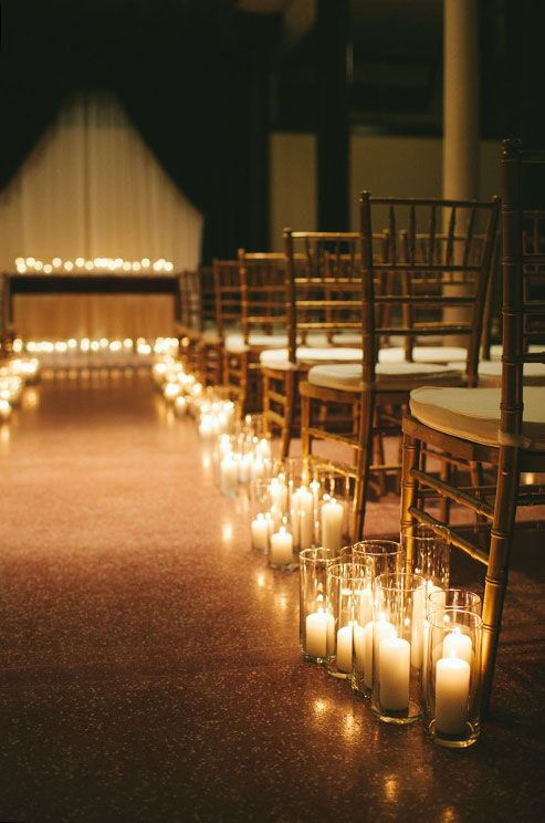 Cers Of Pillar Candles In Hurricane Gles Create An Enchanted Aisle For This Wedding Ceremony
