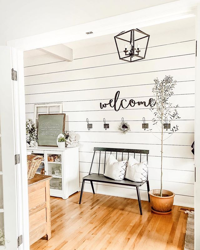 Beautiful white shiplap entry with black iron accents and honey oak floors. Farmhouse cottage…