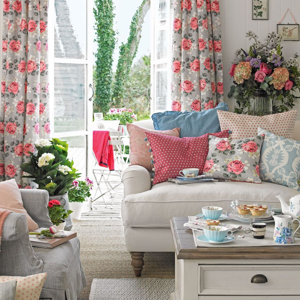 Shabby Chic Living Room With Floral Curtains And Patterned Cushions