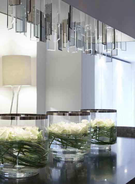 White Roses In Glass Tank Vases With Wrapped Leaves   Fiona Barratt  Interiors   Nice Idea For Beside The Basin