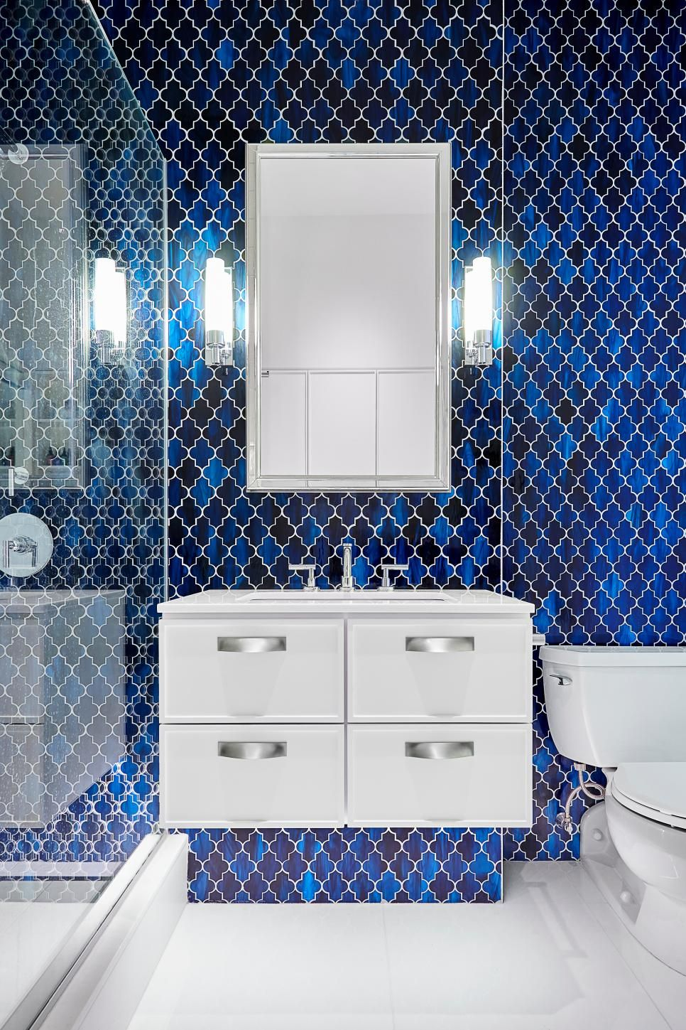 Blue Moroccan-style tiles make a powerful backsplash in this ...