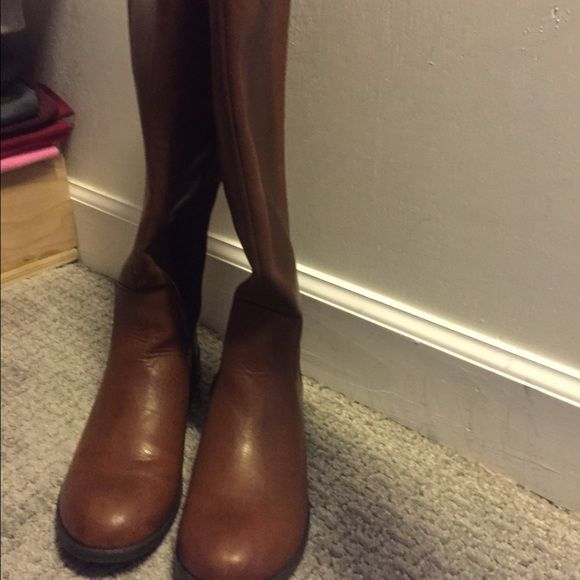 Brown riding boots CHRISTMAS SALE. Awesome wearing boot and super cute, I just got two pairs of riding boots for Christmas and needed to sell one of them. Marshalls Shoes Winter & Rain Boots