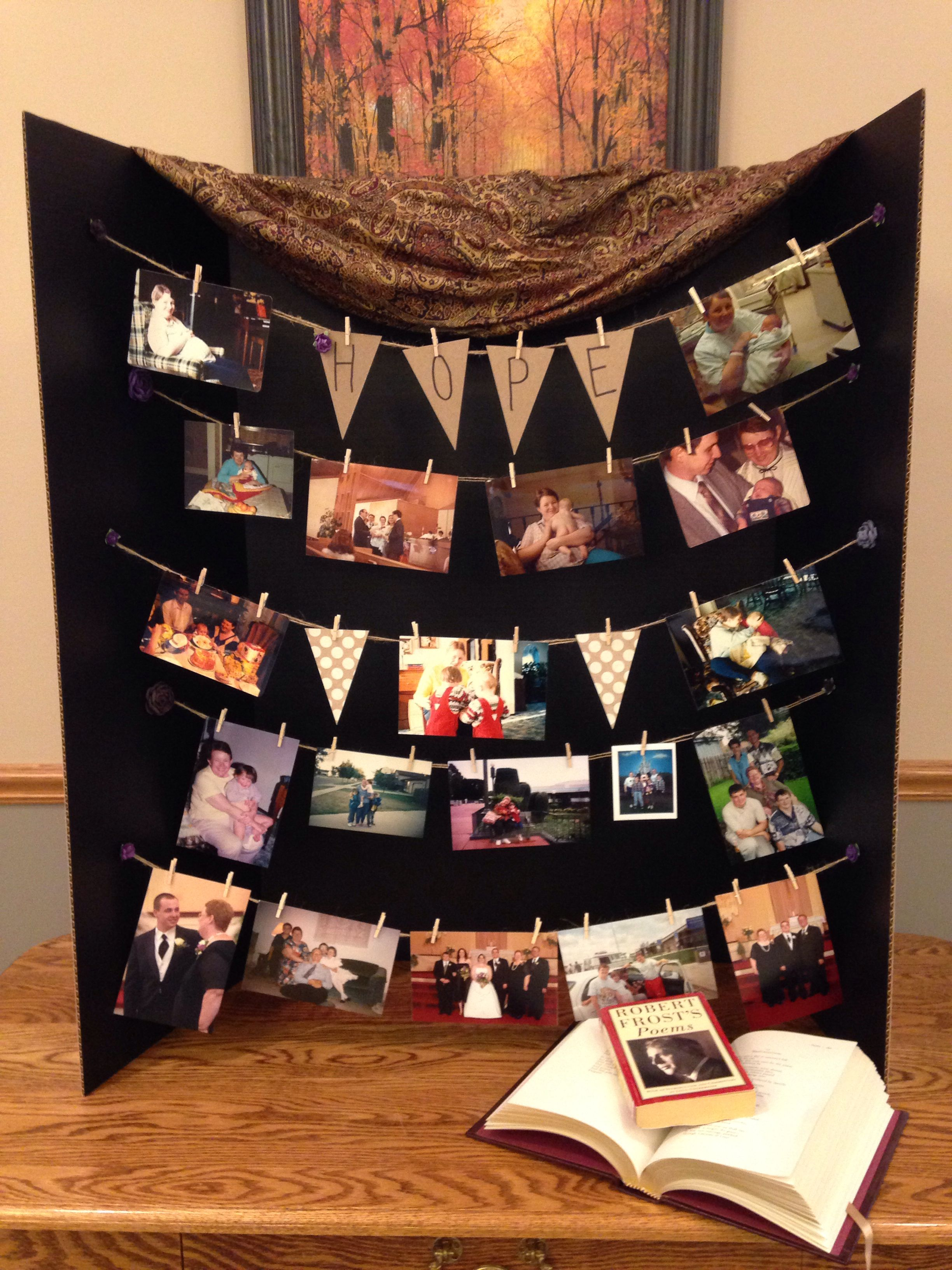 funeral or memorial photo board using twine mini clothespins and a