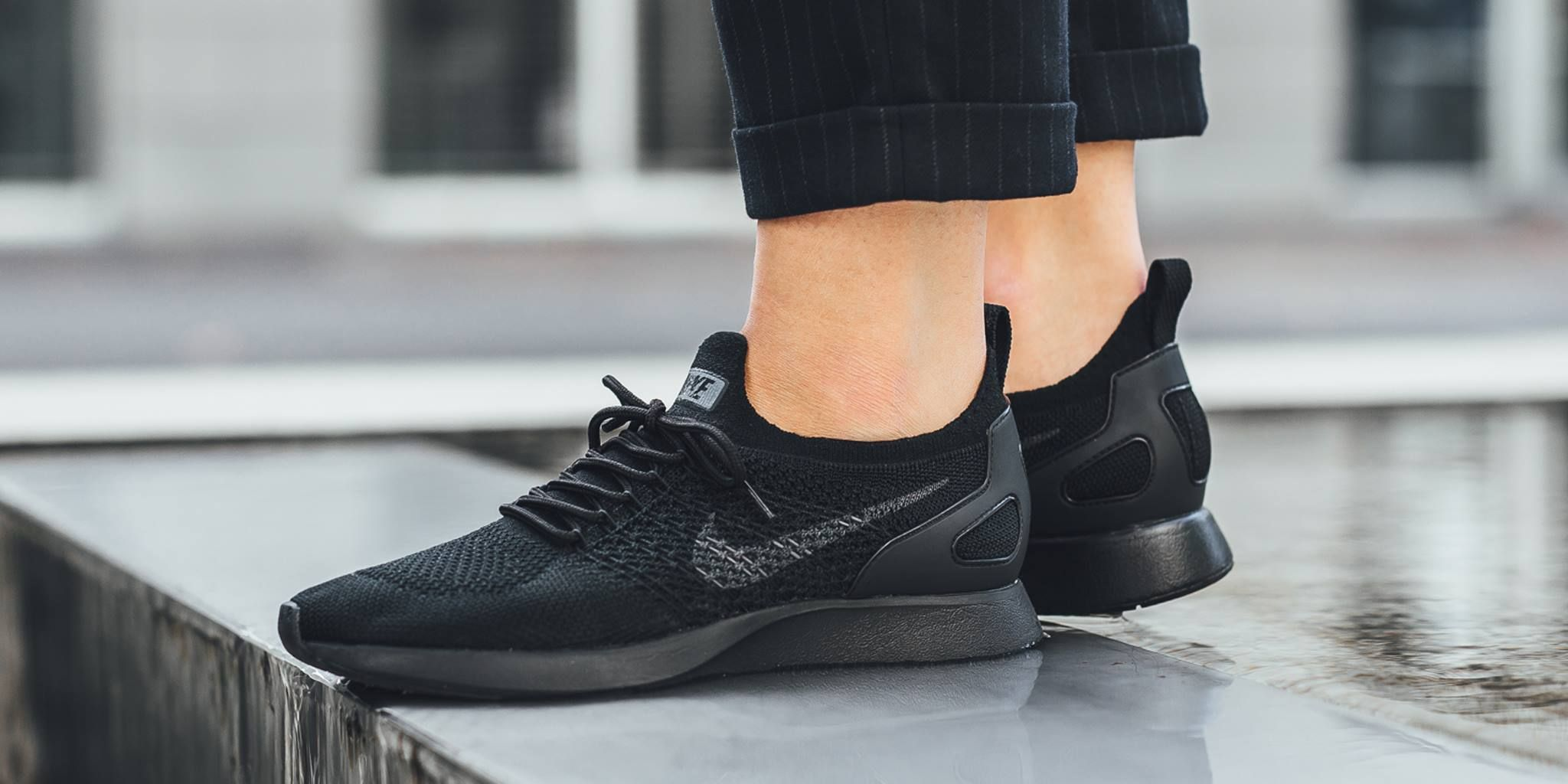 Triple Black Lands On The Nike Air Zoom Mariah Flyknit Racer ... c992856aca