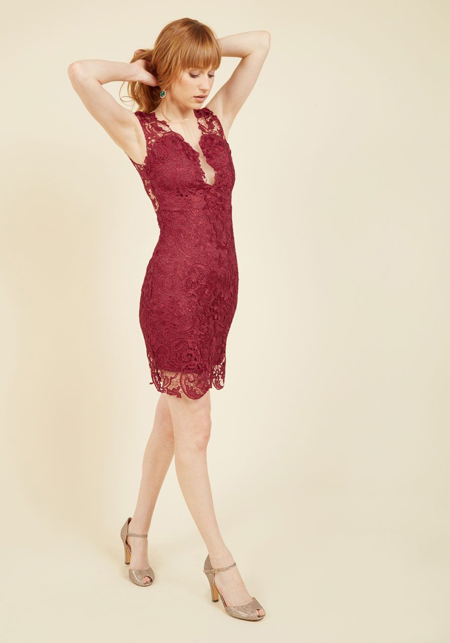 You'll feel the significance of change from the moment you don this lace dress. What was once a simple evening is transformed by the plunging illusion neck and backline, floral overlay, and rich burgundy hue of this sheath into a notable evening you'll always remember.
