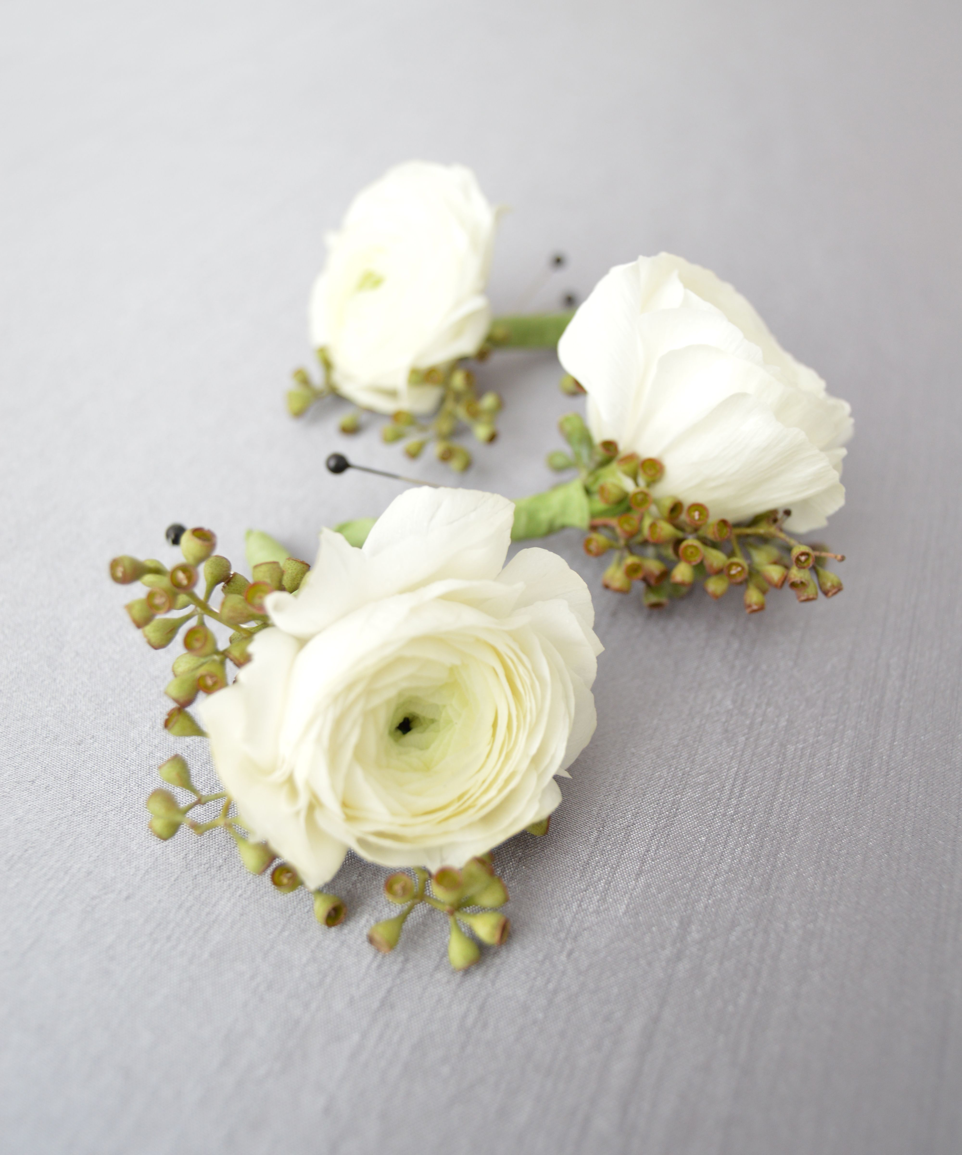 White Ranunculus Eucalyptus Pod Boutonniere Made By Holliday Flowers Events For A Spring Memphis Wedding White Ranunculus Memphis Weddings Boutonniere