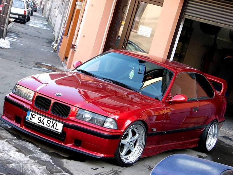 Candy apple red BMW e36 coupé on cult classic OZ Mito II wheels