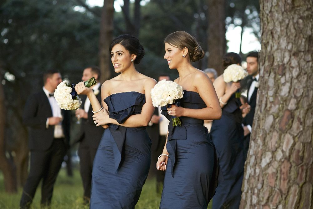 Navy Blue bridesmaids with white bouquet | itakeyou.co.uk
