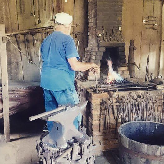 AWESOME Blacksmith in Castine, Maine. He is Hungarian and has an AWESOME SUPER COOL accent. i got to work his giant bellows and help make a fireplace hook for myself!!!!!!! <3