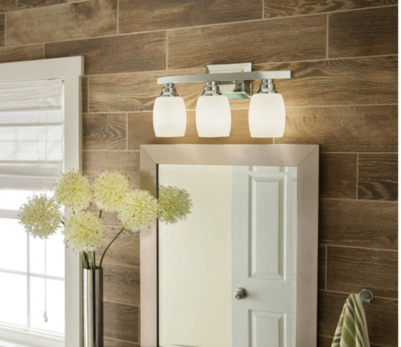 A simple and sleek chrome vanity light bar lends a cool glow with its dimmable feature. Shop this affordable fixture now.