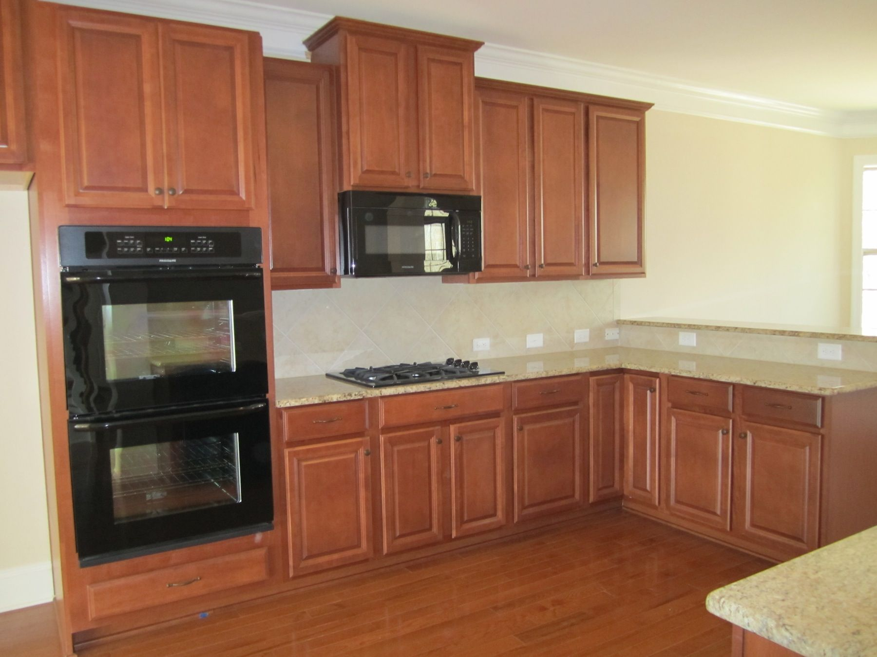 Lovely Tahoe Maple Cognac Cabinets