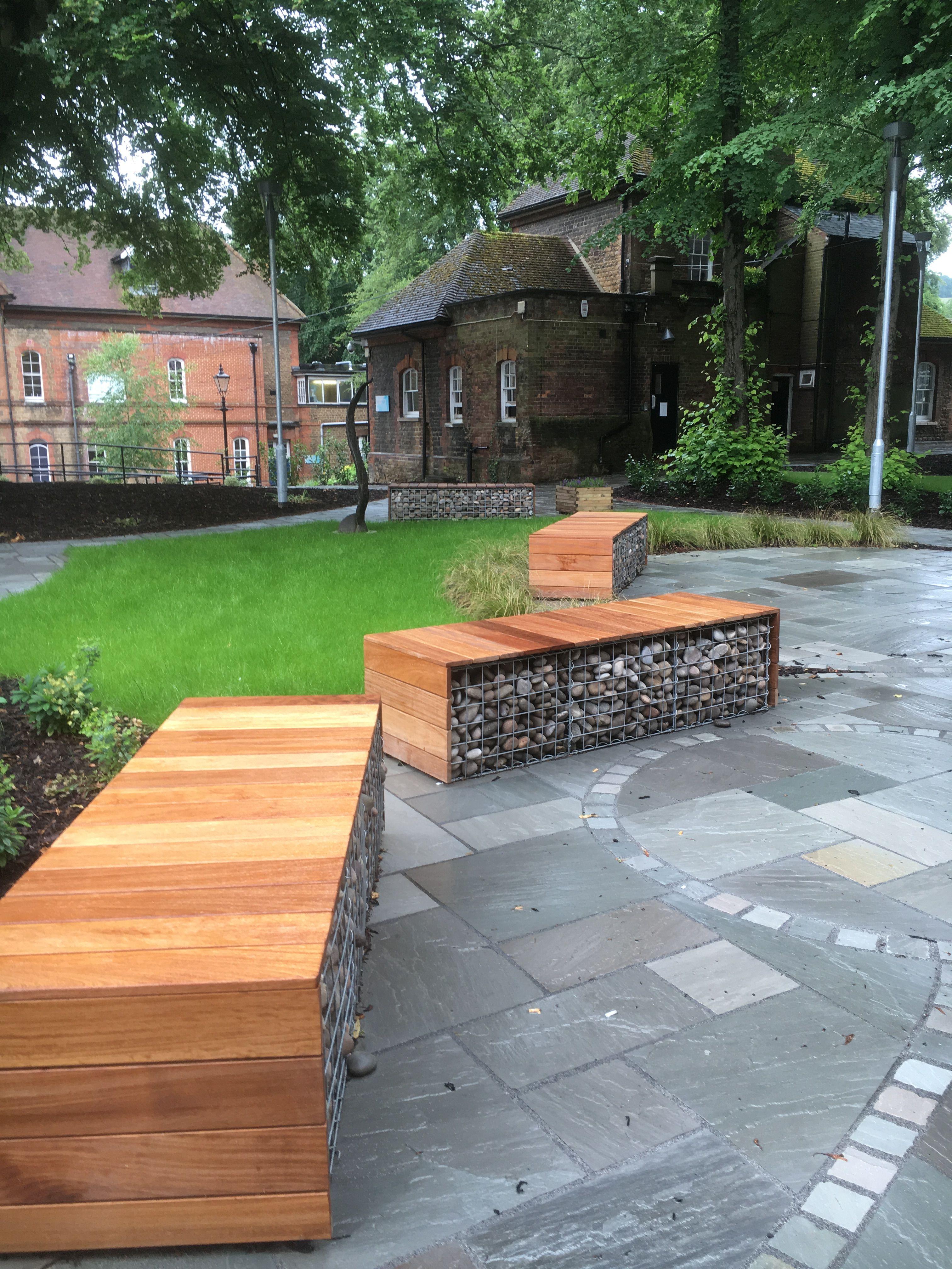 Clever seating idea, using gabion cages and cedar cladding. Farnham ...