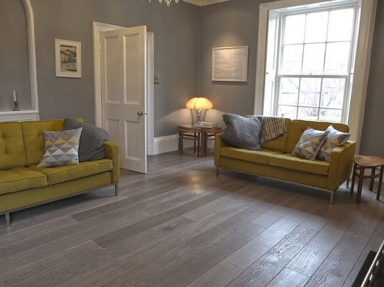 Living Room Laminate Flooring Ideas Grey Wood Laminate Flooring In Living Room With Yellow Sofa .