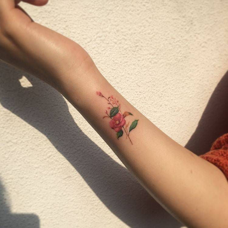 Camellia Flower Tattoo On The Wrist Hibiscus Tattoo Flower Tattoo Hand Hand Tattoos