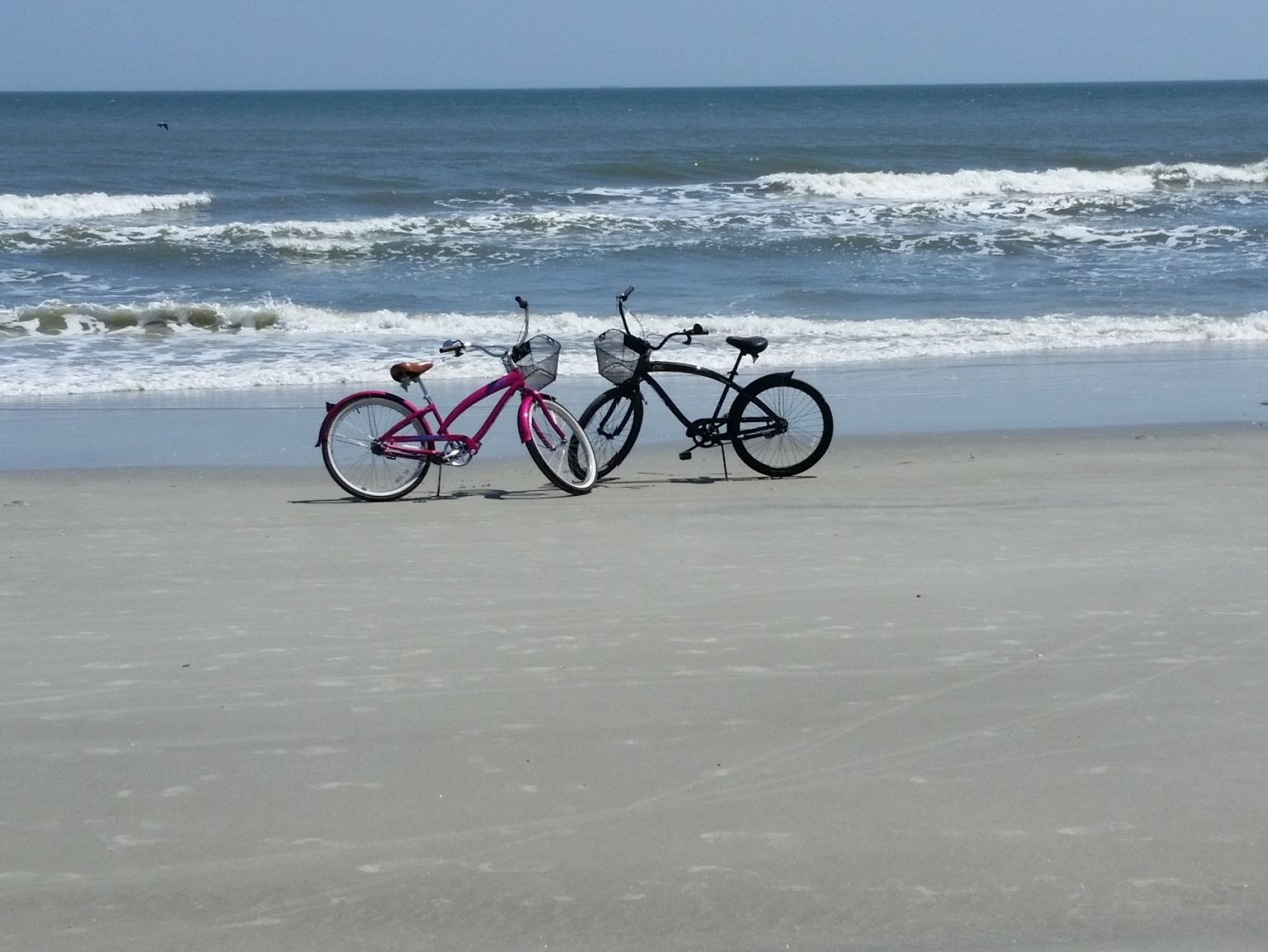 Our bikes on the beach at the entrance from Shipyard