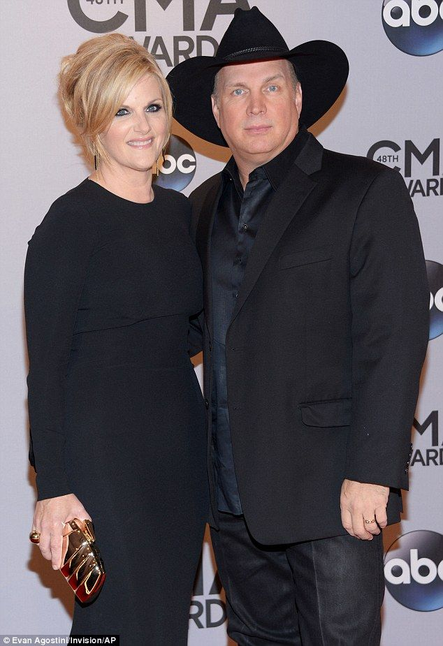 In love: Garth used an interview last year to express his passion for his wife ...