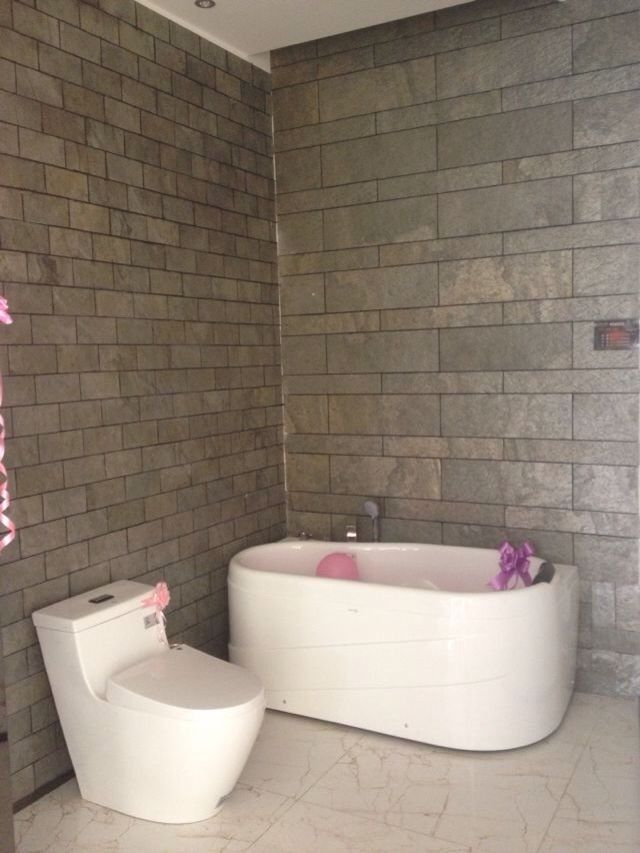 Slate Tiles Veneer Sheet To Cover Bathroom Walls With A Mixed Size Tile  Pattern.